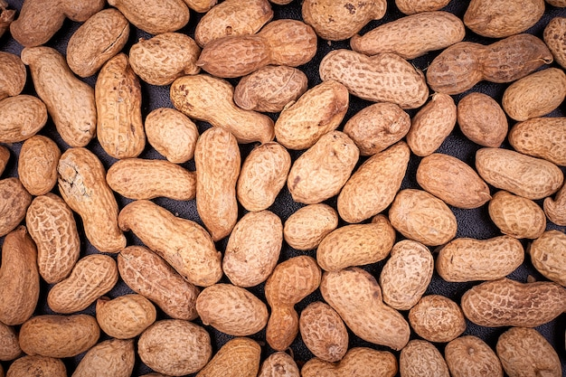 Peanuts photographed on a black background