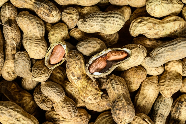 Peanuts in a shell. organic raw groundnut. black background. top view