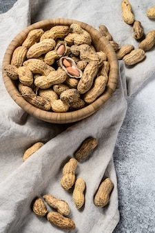 Peanuts in a shell. organic raw groundnut. gray background. top view. space for text