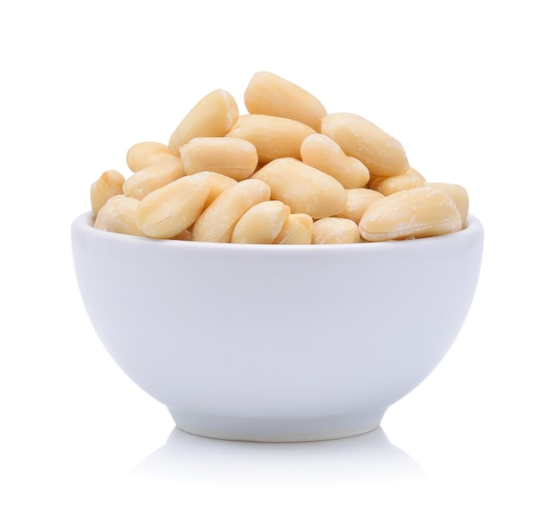 Peanuts in a wood bowl on white