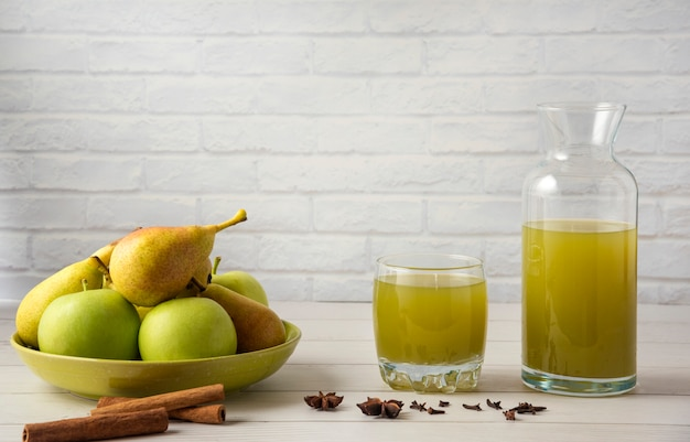 Pear and apple juice with cinnamon flavour in glass cup
