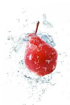 Pear falling in water