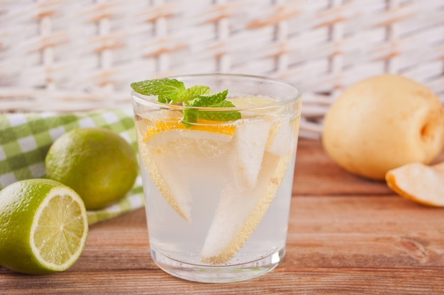 Pear lemonade or mojito cocktail with pear, lemon and mint, cold refreshing drink or beverage