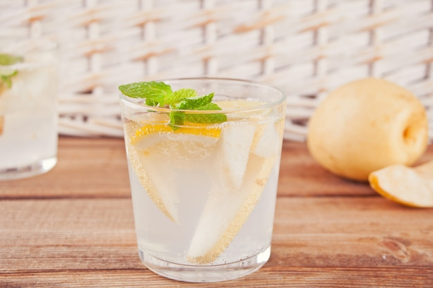Pear lemonade or mojito cocktail with pear, lemon and mint