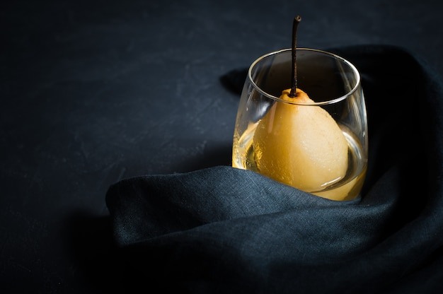 Pear poached in a glass, cooked on white wine.