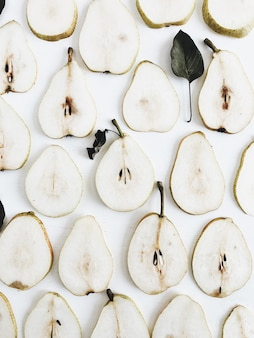 Pear slices pattern on white background. flat lay, top view