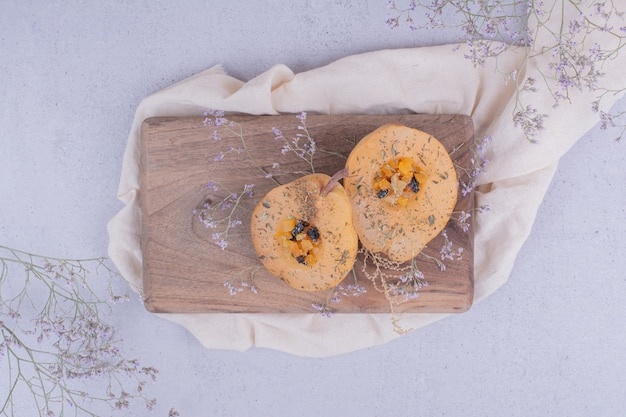 Pear slices with herbs and spices on a wooden board