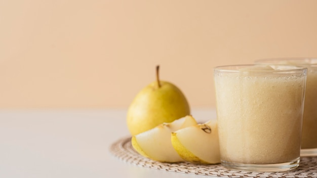 Pear smoothie in glass arrangement
