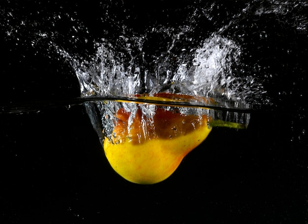 Pear splashes into water