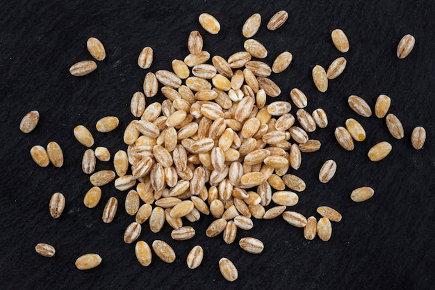 Pearl barley on black background