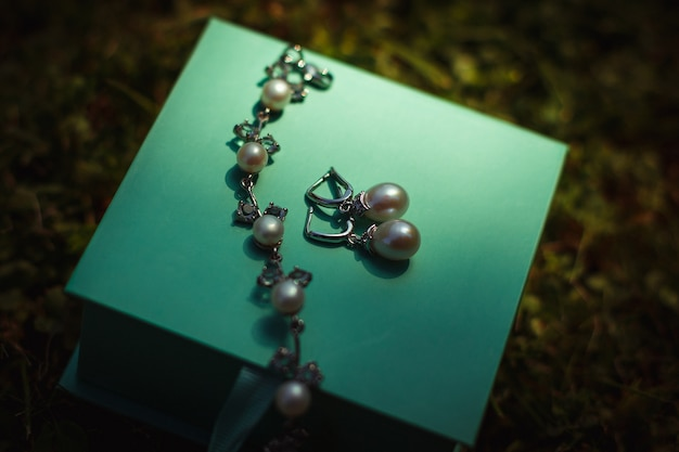 Pearl jewerly lies on mint box