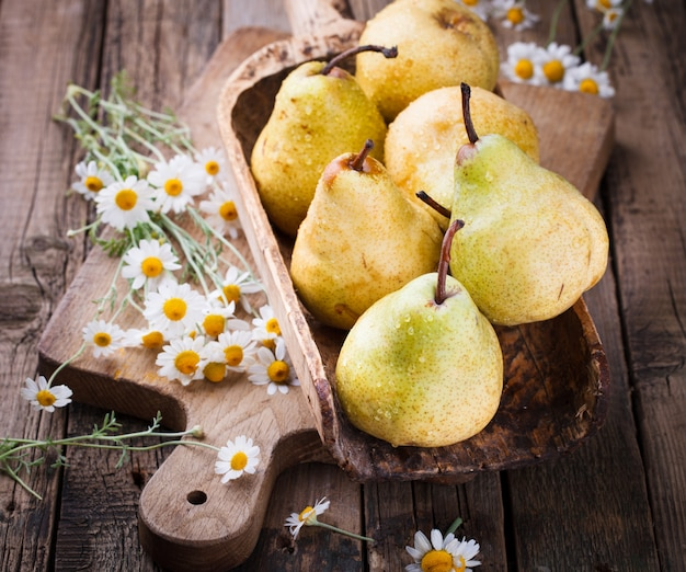 Pears on the aged wooden background