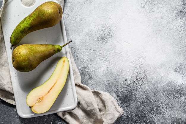 Pears on kraft paper. seasonal ripe pears. gray background. top view. space for text