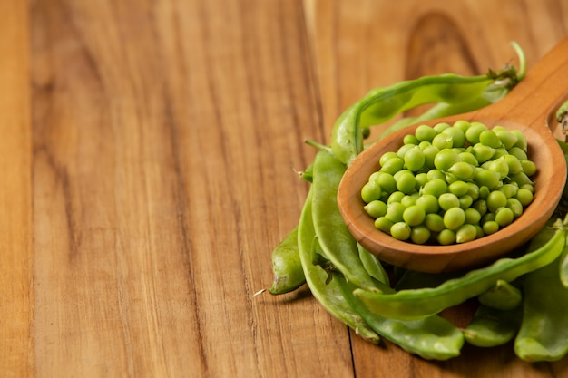 Peas laid on a wooden floor.