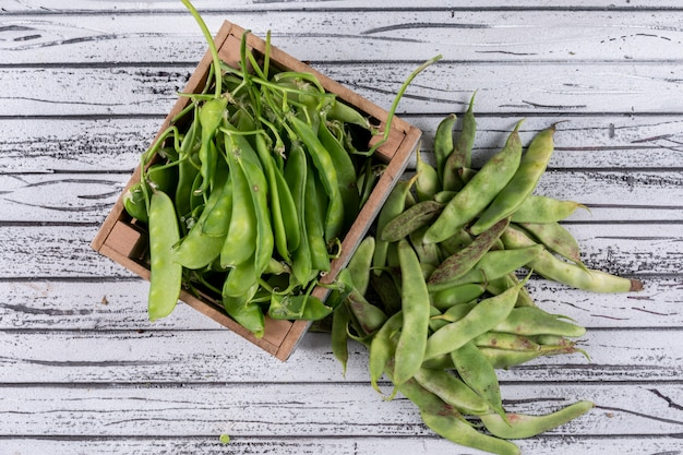 Peas in wooden box and aside