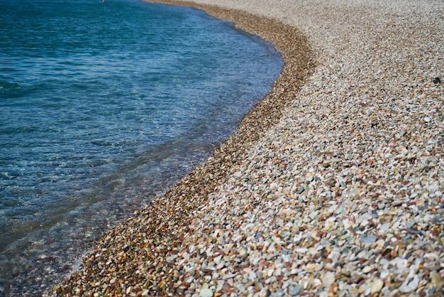 Pebble stone and sea background