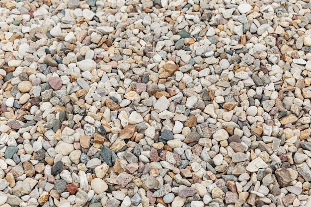 Pebble texture. a large pile of stones. background. space for text.