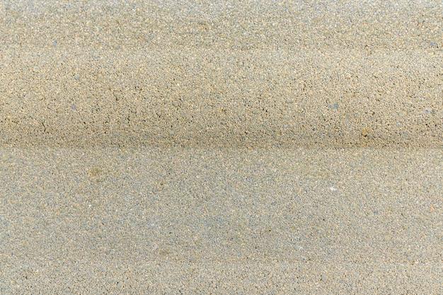 Pebbles in the concrete. beautiful stone floor path.