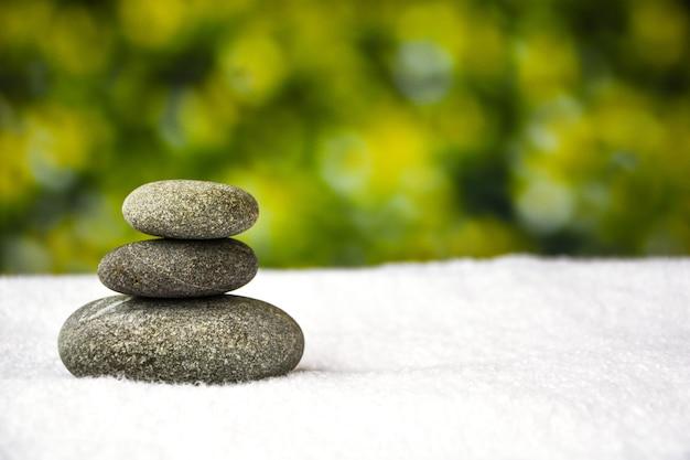 Pebbles stack, balance, pyramid of stones for meditation, stack of zen stones Premium Photo