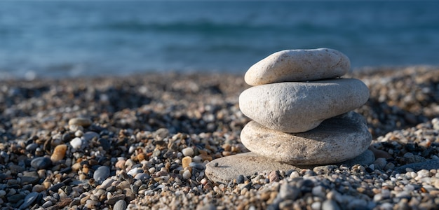Pebbles stacked evenly on the beach.