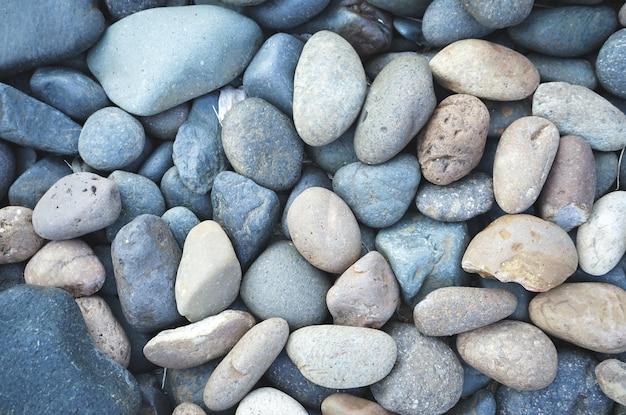Каменный фон из гальки с винтажным фильтром Premium Фотографии