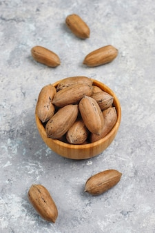 Pecan nuts on light background