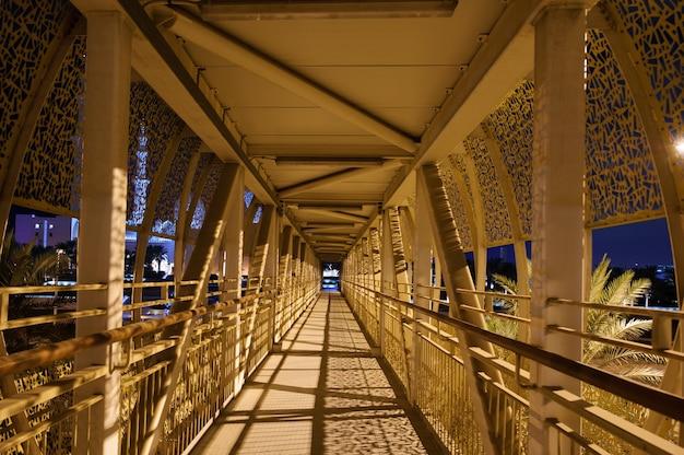 Pedestrian bridge to grand mosque in abu dhabi, united arab emirates