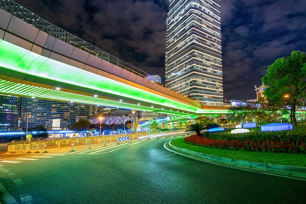 Under the pedestrian bridge of shanghai cityscape at night, china