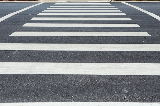 Pedestrian crossing, zebra traffic walk way on asphalt road