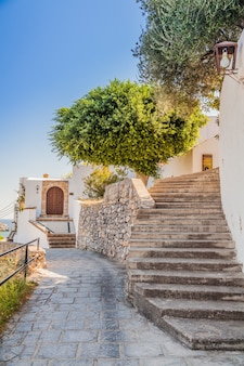 Pedestrian street with stairs in lindos, rhodes, greece