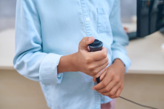 Pediatric patient undergoing a hearing screening procedure