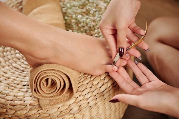 Pedicurist cutting cuticle