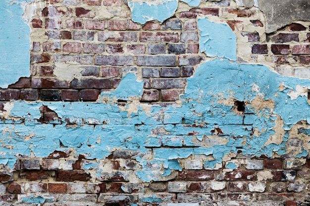 Peeled blue painted brick walls texture