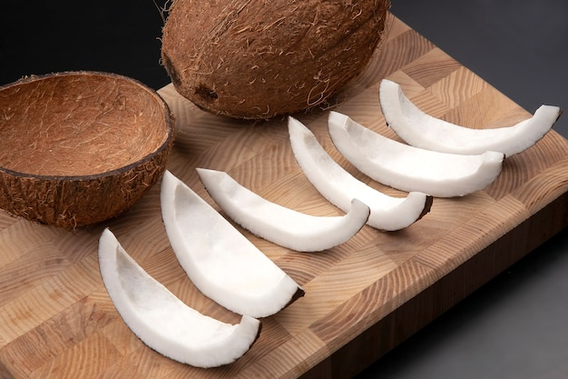 Peeled coconut on a wooden board. vitamin fruits. healthy food