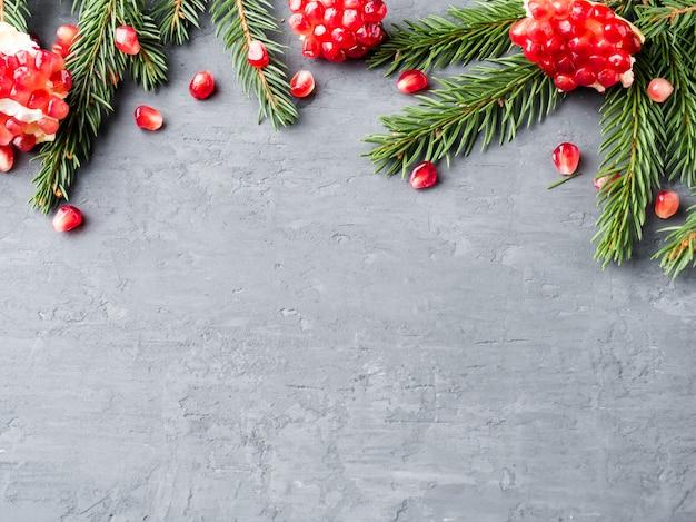 Peeled juicy red garnet in a vintage plate on christmas tree