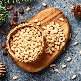 Peeled pine nuts on gray background