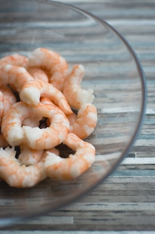 Peeled shrimps in glass bowl