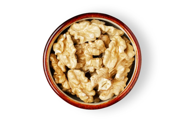 Peeled walnut kernels in a bowl. isolated on a white background. nuts contain vegetable protein and vitamins. for a healthy and vegetarian diet.