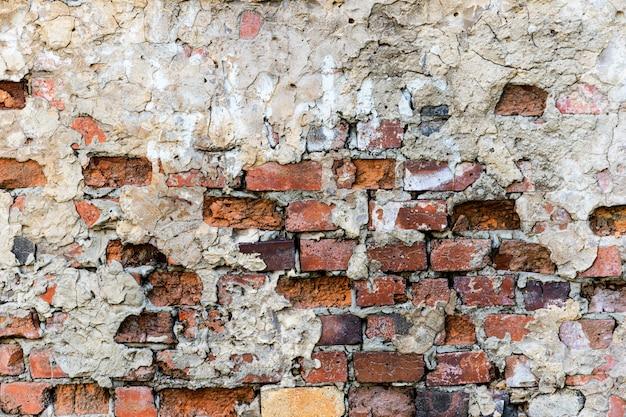 Пилинг старой кирпичной стены, гранж текстуры