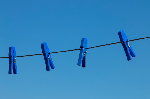 Pegs on a wire