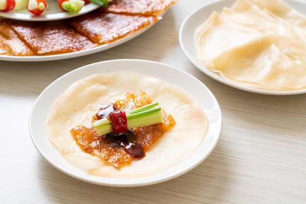 Peking duck with sauce and ingredients
