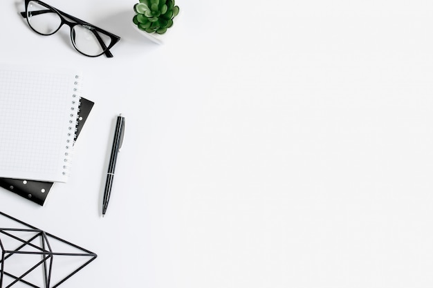 Pen, eye glasses, notebook, succulents plant, office tools