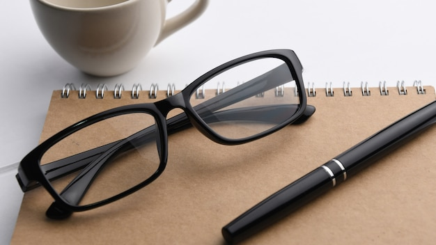 Pen and glasses on a notebook