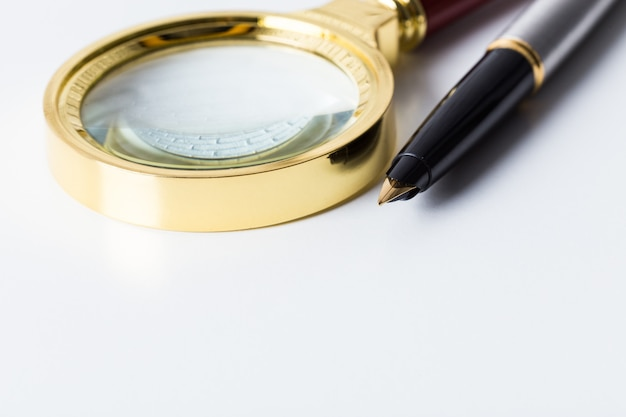 Pen and magnifying glass