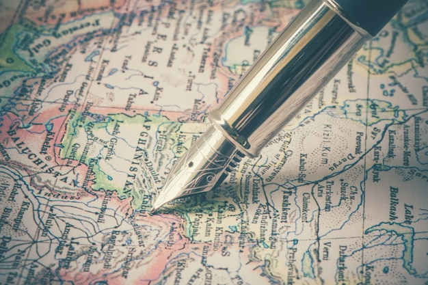 Pen and a map  with filter effect retro vintage style