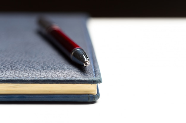 Pen and notebook close up
