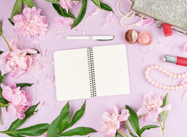 Pen notebook with blank white pages, bouquet of peonies
