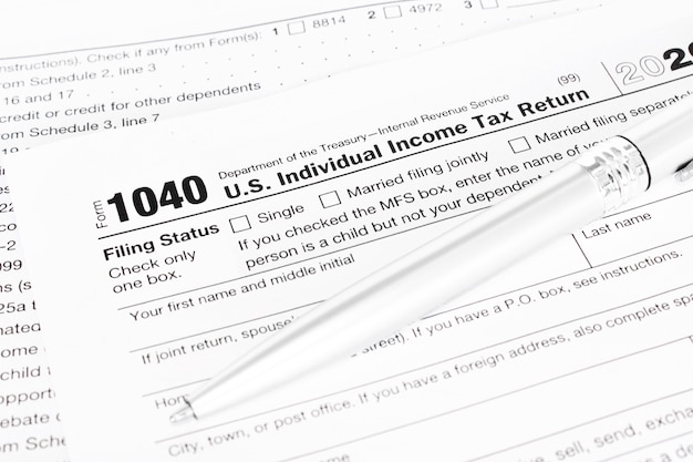 Pen on tax form 1040. business concept.