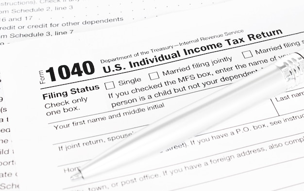 Pen on tax form 1040.