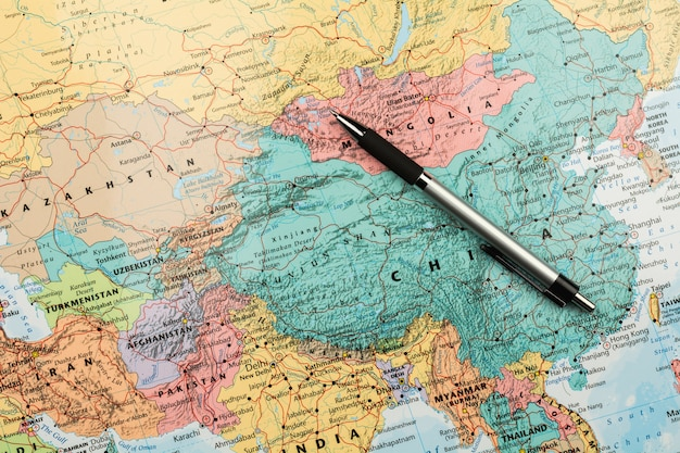 Pen on world map.